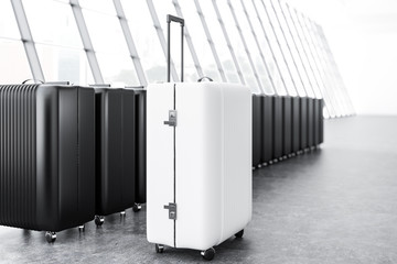 White and black suitcases in airport side view
