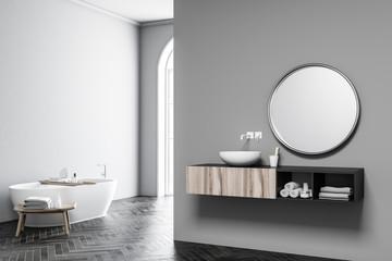 Grey arched window bathroom, tub and sink