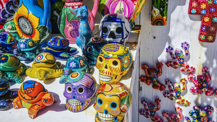 Decorated colorful skulls, ceramics death symbol at market, day of dead, Mexico