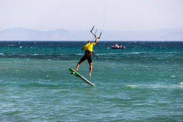 Kitesurfers on the water in Tarifa, Cadiz, Spain.