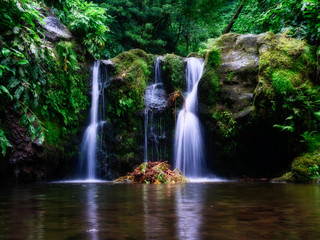 Long exposure picture of a beautiful waterfall with little lake in the rain forest. long exposure