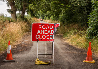 Road closed signs due to badger damage of a local road, Pickmere, Knutsford, Cheshire, UK