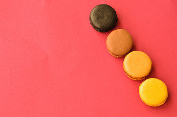 four macaroons on a pink background with a place under the text