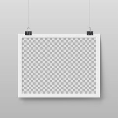 Realistic blank photo frame hanging on binder clips. Layout for art gallery design. Mockup picture frame with white border. Transparent empty place for artwork. Interior decoration vector element