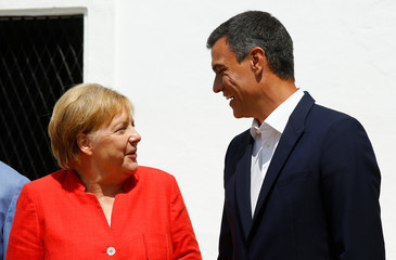 Spain's Prime Minister Pedro Sanchez talks with German Chancellor Angela Merkel before a lunch as part of her informal two-day visit in Sanlucar de Barrameda