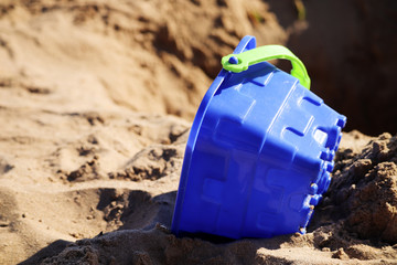 Sand castle bucket on the beach