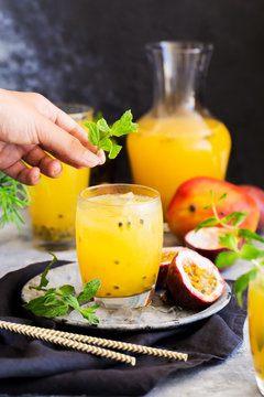 Summer cold mango passion fruit lemonade decorated fresh mint