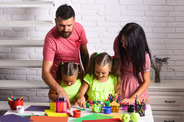 Children playing and learning with parents