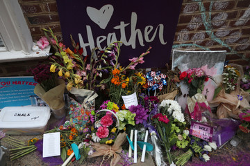 "Flowers and messages are left at a memorial to Heather Heyer ahead of the one year anniversary of 2017 Charlottesville ""Unite the Right"" protests, in Charlottesville"
