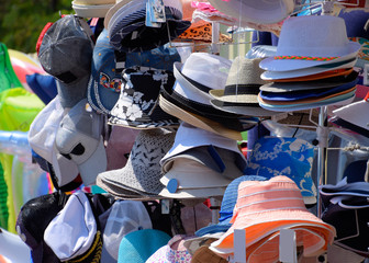 Hats from the sun. Hats in the market are sold in a shop.