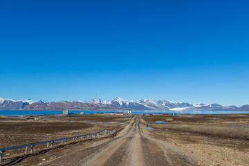 street to Ny Alesund town, Svalbard, Spitsbergen, blue sky
