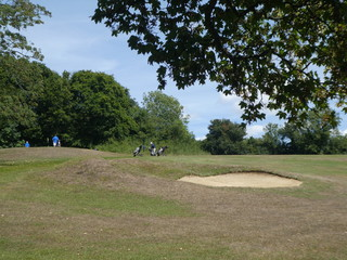 Golfers by the sand trap