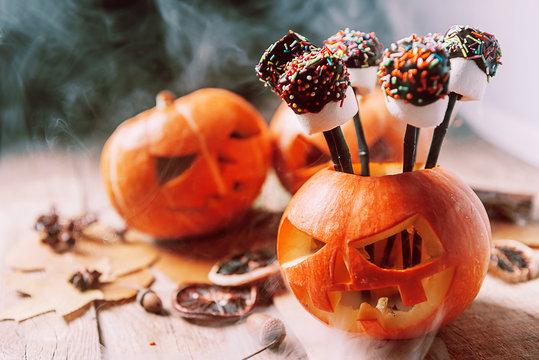 marshmallow stylized to celebrate halloween on a pumpkin background