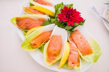 Salmon starter served on a cabbage leaf
