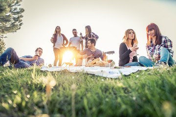 Friends doing picnic and grilling outdoors