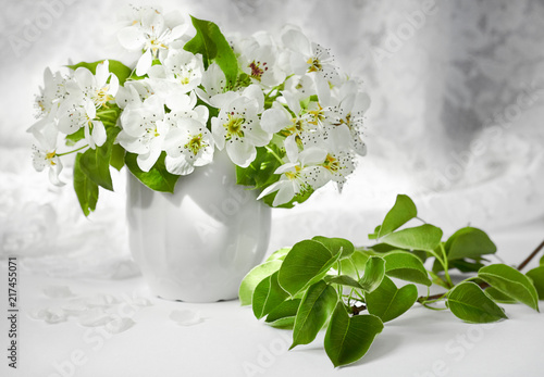 Bunch Of White Flowers And A Branch Of A Pear Tree In Front Of Folds