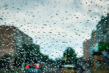 Raindrops On Window With Defocused Buildings In The Background