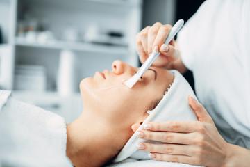 Beautician makes rejuvenation procedure to patient