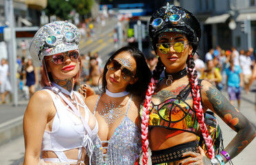 Revellers pose before the Street Parade dance music event in Zurich