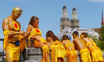 Revellers await the Street Parade dance music event in Zurich