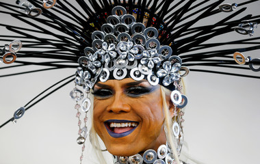 A reveller smiles during the Street Parade dance music event in Zurich
