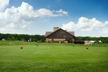 Four color balls on golf course, launching pad