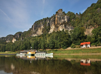 Elbe river and Bastei at Elbe sandstone mountains near Rathen village. Saxon Switzerland National Park. Germany