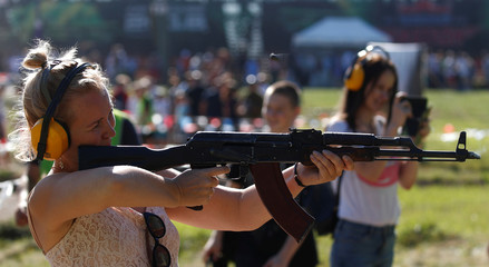 A woman shoots a Kalashnikov automatic rifle at the International Army Games 2018 in Alabino