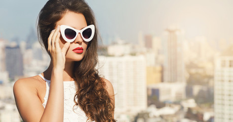Portrait of beautiful young woman wearing sunglasses