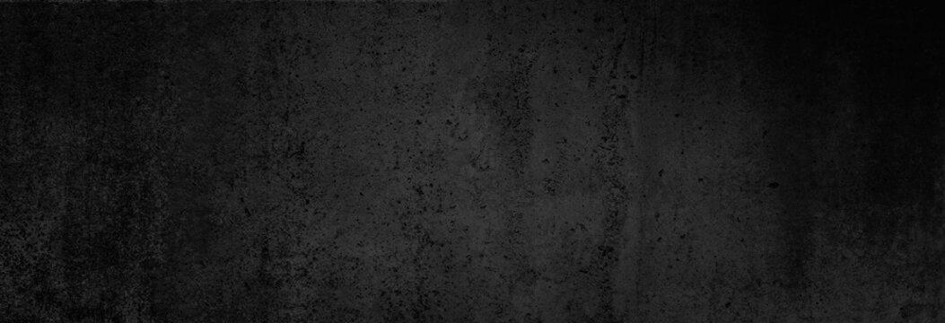 Beton-Textur in fast schwarz in XXL-Größe als Hintergrund, auf die Betonwand fällt ganz leichtes Licht