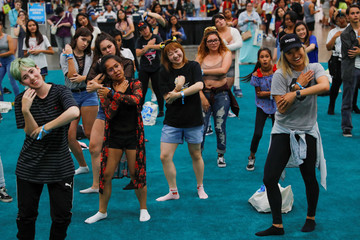 Attendees and K-pop fans learn dance moves at KCON USA, billed as the world's largest Korean culture convention and music festival, in Los Angeles