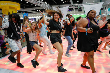 Attendees dance to K-pop songs at KCON USA, billed as the world's largest Korean culture convention and music festival, in Los Angeles
