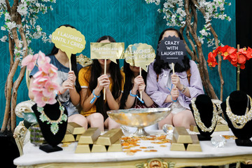 "Attendees pose for a picture at a booth promoting the new movie ""Crazy Rich Asians"" as they participate at KCON USA Los Angeles"
