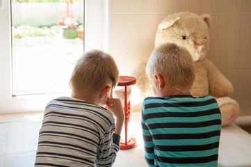 happy children with hourglass in bathroom