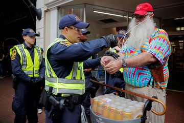 Police detain a man after he bought banned items in a store within the secure zone in Charlottesville