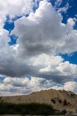 view of a landscape under a cloudy sky