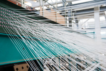 Yarn thread running in the machine Fotomurales