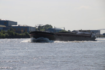 Inland freight ships on river Lek which transport seafreight to harbors in Germany and Switzerland.