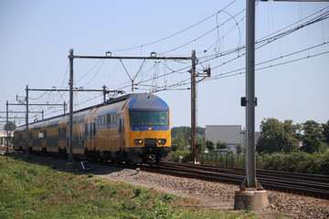 Double decker train at the rails heading to Rotterdam in the Netherlands.