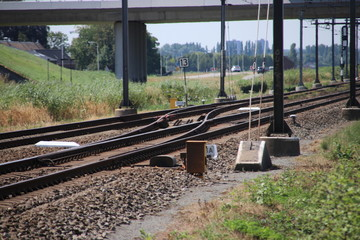 Railroad track at Moordrecht heading to Rotterdam in the Netherlands with a switch.