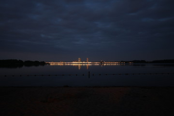 The Nesselande beach and district lights in the evening is reflecting on the water of the Zevenhuizerplas, taken from Oud Verlaat in the Netherlands