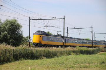 Intercity train on the track at Moordrecht heading to Rotterdam in the Netherlands