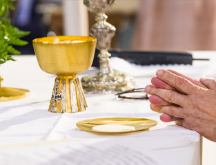 the hands of the Pope consecrate the host, the holy bread in the body of Christ