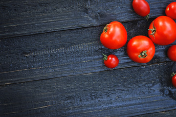 Ripe red tomatoes on a wooden table with copy space