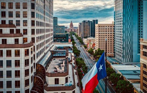 Texas Flag Over Congress Avenue In Austin, Texas