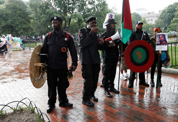Members of the New Black Panther Party for Self Defense gather outside the White House in Washington
