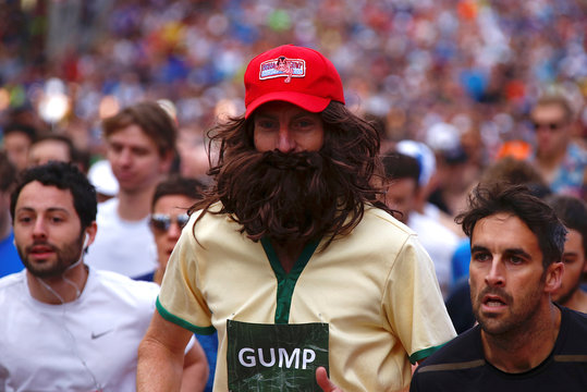 A man dressed in costume runs with other participants at the start of the annual City to Surf fun race from Sydney's CBD to the iconic Bondi Beach