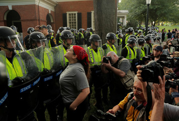 Virginia State Police officers form a cordon at the University of Virginia in Charlottesville