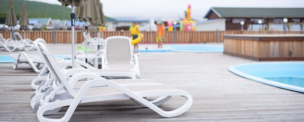 Banner Wooden deck beach sea ocean resort sun lounger umbrella hotel pool sky sunrise.