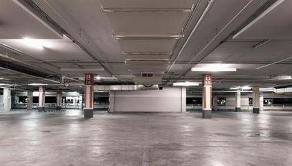 Empty modern car parking garage interior background.